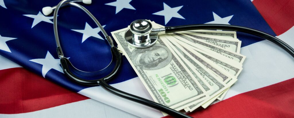 American flag with cash and stethoscope