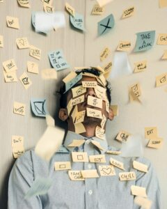 man buried by post-it notes