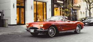 1962 cherry red Corvette driven by a bookkeeper