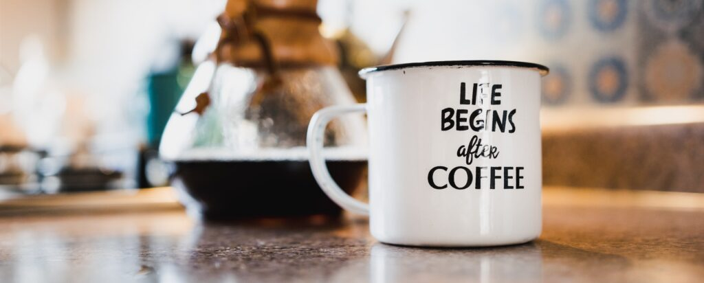 Coffee cup on employee's home desk