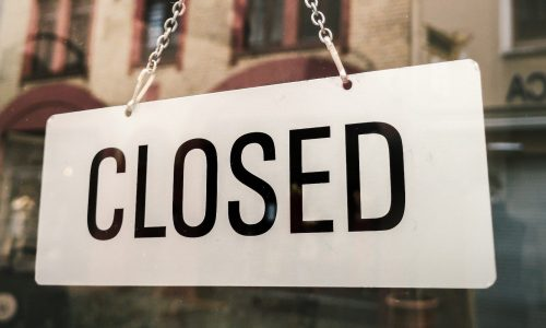 Small Business closure sign on window